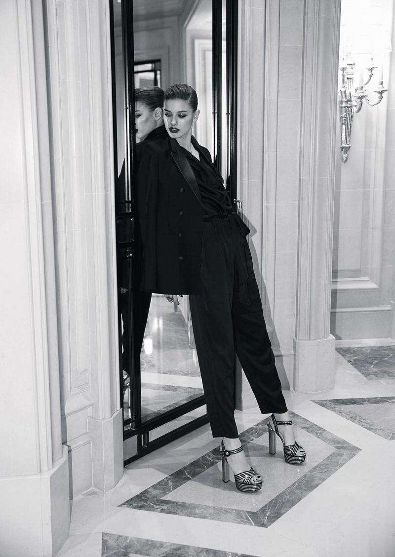 Jumpsuit, Diane von Furstenberg. Blazer, Hugo Boss. Ring, Carole Tanenbaum. Shoes, Prada.