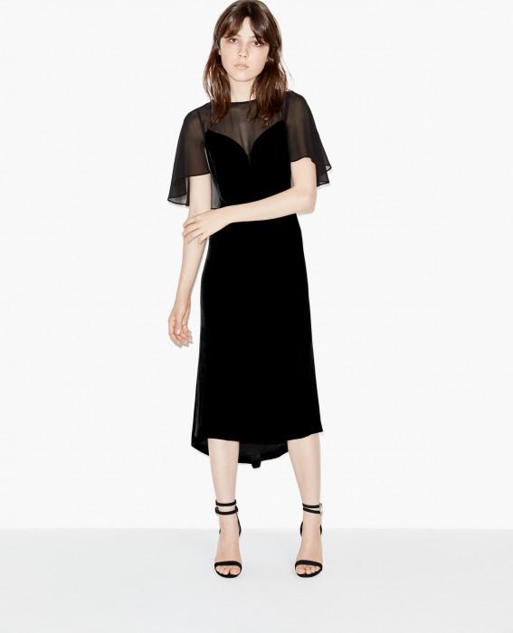Robe de soirée noire longue tendance 2017 - Modèle The Kooples Cette robe du soir mi-longue en velours se distingue par son voile transparent qui couvre le haut de la poitrine et drape les épaules. Elle conviendra parfaitement à une soirée habillée.