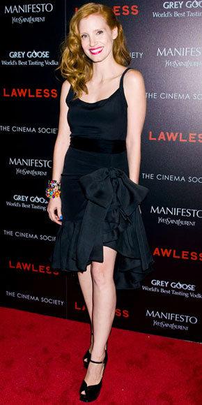 Jessica Chastain a montré ses jambes de mille de long dans une robe de cocktail vintage asymétrique-hemline YSL à la projection Lawless.