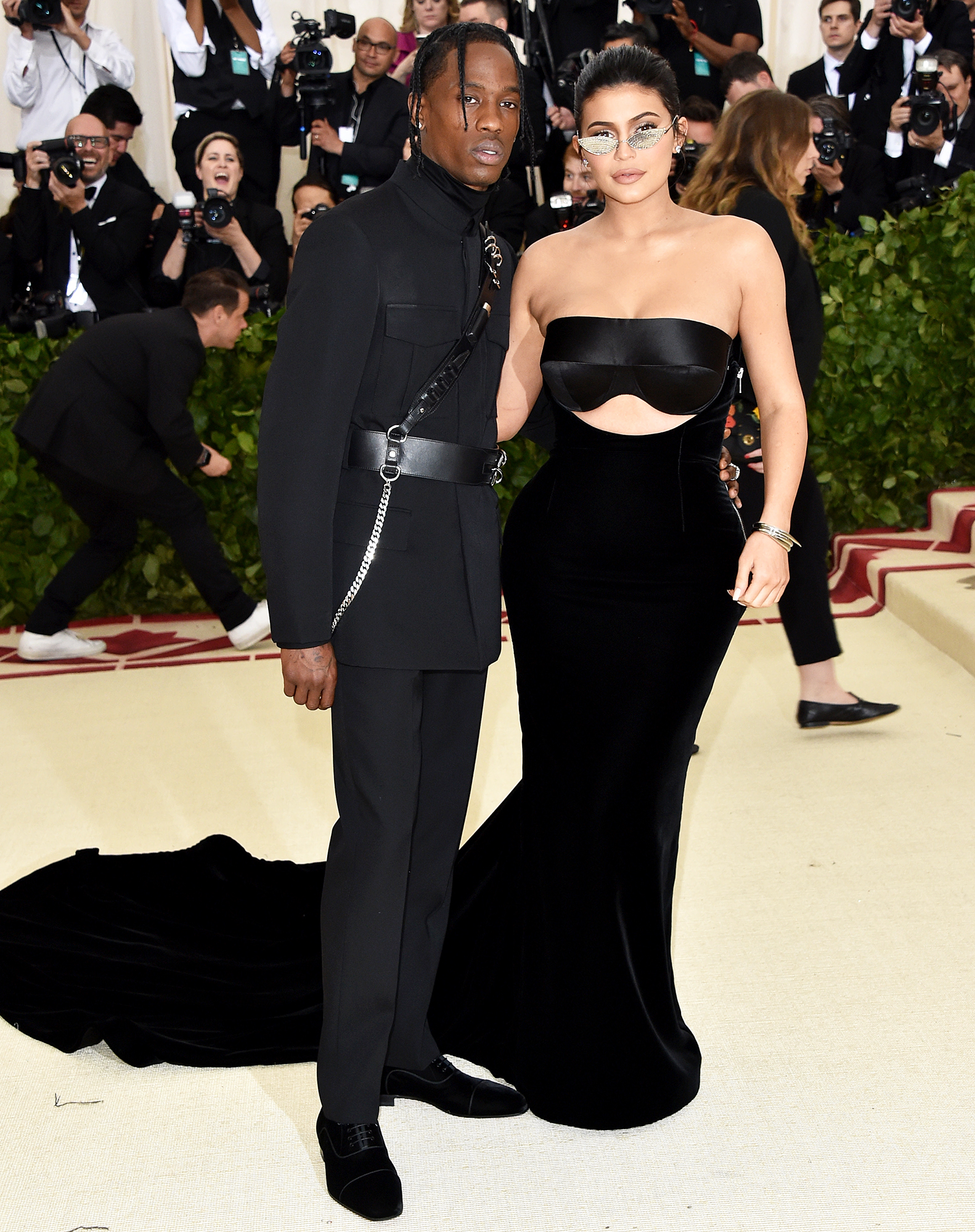 Travis Scott in Christian Louboutin shoes and Kylie Jenner in Alexander Wang and Chopard jewelry