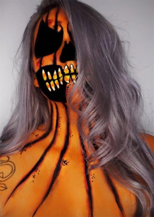 Terreur de citrouille : L'espace négatif est le meilleur atout pour cette idée de maquillage d'Halloween. Ça rend le regard terrifiant, alors que la mâchoire pleine de dents en sucre d'orge est un peu fantaisiste.